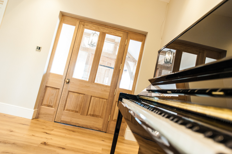A timber bespoke door in a feature property in Bath