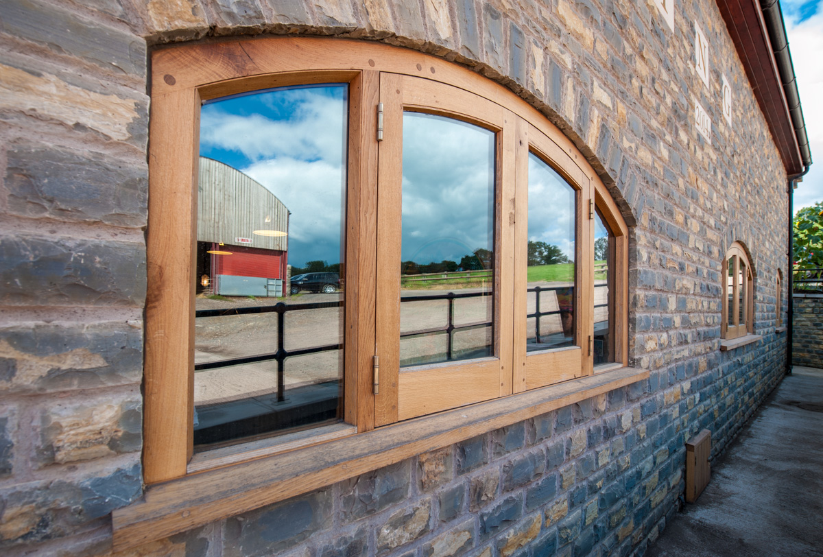 Curved bespoke timber framed window fitted in a property in somerset near Bristol